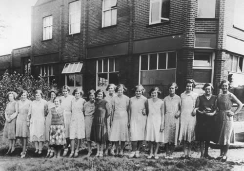 Homeknit employees outside the factory