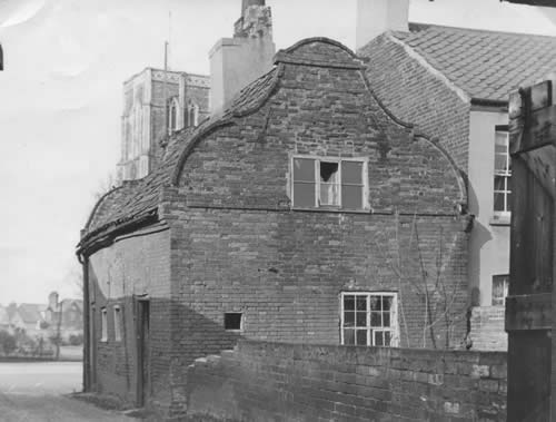 View of the cottages from the rear before restoration.