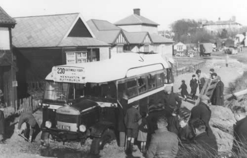 The Wenhaston and Blythburgh bus gets bogged down on Ferry Road en route to Southwold Ferry. 12 February 1938