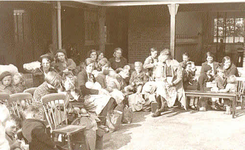 Evacuees from London waiting at Southwold School to be billetted